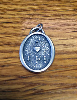Photo of the Front of the Braille Charm